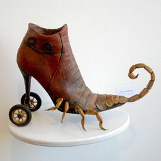 This is an one of a kind sculpture and no reproduction has ever been made. The shoe ( life-size) is made of fiberglass and it is very strong. The wheels are real wooden wheels and the scorpion is made of polymer clay.