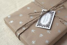 DIY Kraft Paper Gift Wrap - use recyclable kraft paper and customize with white or silver Sharpie paint markers #Witandwhistle