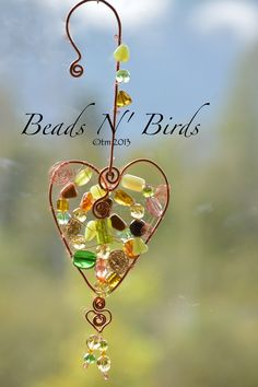 """HEARTS Suncatcher created by: Coirnini Company © ™ Custom Made For You:  The beautiful HEART is adorn with fall glass beads. Display in a window, rearview Mirror or a place where you love to sit. If you would like to """"Purchase a beautiful heart like this one, visit: www.facebook.com/coirninico or send an email to: coirnini@gmail.com You can also shop at my store: https://www.etsy.com/ca/shop/CoirniniCompany"""