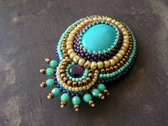 Bead embroidery brooch Beadwork brooch Turquoise brooch Turquoise Purple Copper Beige Spring jewelry MADE TO ORDER. $42.00, via Etsy.