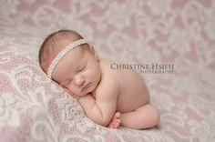 newborn girl with pearl halo