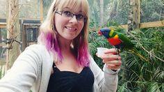Feeding the lorikeets at Brevard Zoo