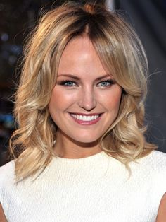 Malin Akerman ~ The actress wows the crowd with her perfect coif -- a combination of medium layers and loose curls -- a look that's best acheived with a jumbo iron or hot rollers. ~