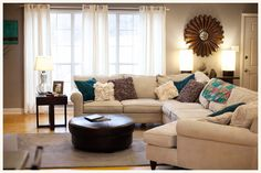 Love it Kelly Moore's living room, love the color and decor and we should really trade our couches for a sectional with bright throw pillows!