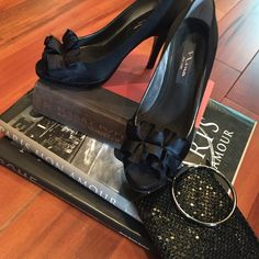 Black satin peep toe bow Nina heels! Ready for a night out these black satin Nina heels are super cute! Good pre loved condition with no sign of wear except on the soles (pictured). They come with the box! Feel free to ask questions!  Nina Shoes Heels
