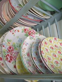 Cath Kidston plates and cutlery- I would only use Cath Kidston cutlery and I would have three different sized and colored plates fastened to the wall as an ornament and the rest in the cupboard.