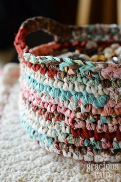 Crocheted caddy in beautiful colours. The strips of fabric are from a Moda Jelly Roll of fabric that were cut in half horizontally.