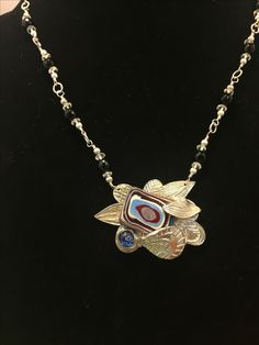 Fordite set in pmc metal clay by artist Laurra Fitzgerald