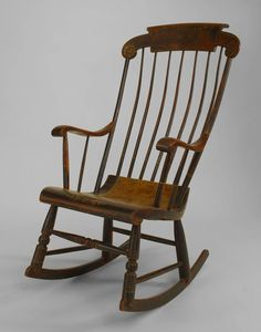 American Country (1st ¼ 19th Cent) Hitchcock style rocking chair with faux wood painted seat and gold stencilled decoration with spindle design back