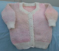 Another cardigan, they are so useful for putting over summer dresses. Again a 20 inch / 51 cm chest and petty in pink and white, the pinky yarn being a multicolour varying between the palest pink, shading to lilac and peach. The crystal effect buttons here allow the colors to speak for themselves. £10.00 + £4.50 signed delivery for this size, other sizes can be made to order. Message me as usual for further information or to order.
