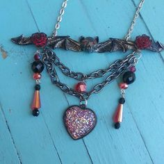 VAMPIRE GODDESS Vampire Goddess necklace.  One of a kind necklace created by me.  Red and black crystals,  red roses, metal bat. Hippie Chic Jewelry
