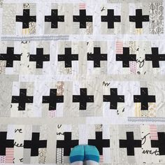 Knit or Crochet  - Black Cross's, shades of white, natural, grey, little bit of red.