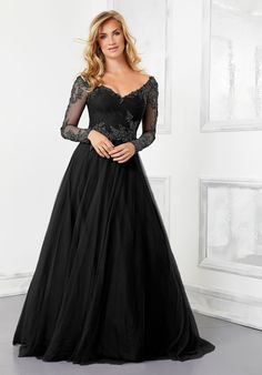25716 - Is it a black wedding gown? Or a formal dress? You decide! Available in Black or Navy. Try this beauty on at Aurora Bridal in Melbourne, FL 321-254-3880 Lace Evening Dresses, Evening Gowns, Dress Lace, Elegant Dresses, Black Wedding Gowns, Mother Of The Bride Gown, A Line Gown, Bride Gowns, Mothers Dresses