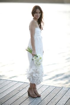Gorgeous #wedding #dress...perfect for a beach style wedding!  From http://oncewed.com/60229/real-weddings/rustic/bay-cottage-wedding/page-3/ Flowers by http://melindatualima.com.au/  Photo Credit: http://sugarloveweddings.com/ with http://mylensoflove.blogspot.com/ and Lauren Michelle