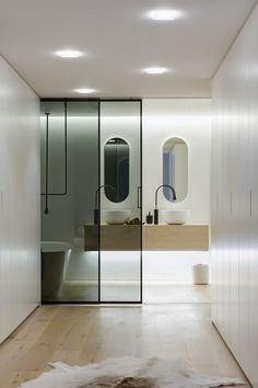 Transparent Valeria Sliding Door System By Rimadesio For The Modern Bathroom With Wooden Floor And White Wall ✿ ✿