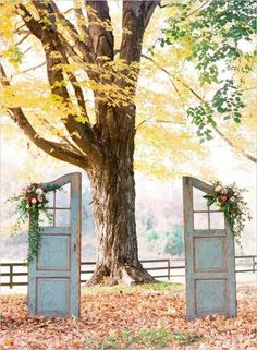 Shabby chic distressed doors as backdrop for an outdoor Autumn wedding ceremony