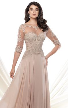 Achieve luxury and sophistication in Mon Cheri Montage 115968. This exceptional evening gown features a bateau neckline. Sheer fabric wraps over the sweetheart lining and three quarter length sleeves. The beaded rich lace generously scattered allover the bodice, with the v-back flatters your silhouette. The skirt is extensively flowing to show off the lovely style. 498.00