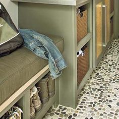 Backed with mesh and grouted in place, tumbled rocks install like ceramic mosaic tile but lend more slip resistance in a busy mudroom.