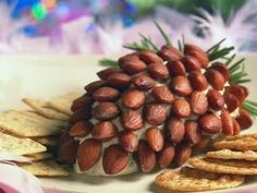 Pinecone Cheese Ball decorated with almonds and rosemary sprigs.