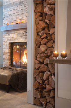 Wood wall - would not have thought of this. I constantly bring wood in for my wood stove. This is creative.not the wood wall but the fireplace behind. Stone for fireplace Range Buche, Interior And Exterior, Interior Design, Cozy Fireplace, Fireplace Cover, Fireplace Stone, Fireplace Design, Wood Holder For Fireplace, Scandinavian Fireplace
