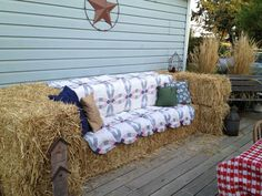 picture of hay bales made into a couch with quilt for family photos on pinterest | Hay bale couch. Made with ten bales, one quilt and a few throw pillows ...
