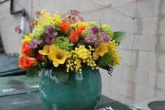 a colourful arrangement ina  tourquoise pot!