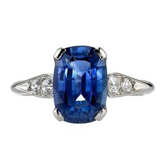 3.77 Carat Cushion cut Sapphire Ring  | From a unique collection of vintage solitaire rings at https://www.1stdibs.com/jewelry/rings/solitaire-rings/