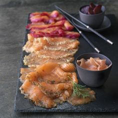 Gravadlax, or gravlax if you prefer, is marinated rather than smoked. It is a traditional Scandinavian approach to preserving fish. We use Grade One Scottish Salmon and apply three different cures:… Christmas Food Hampers, Scottish Salmon, Breakfast Buffet, Cooking Instructions, Food Places, Smoked Salmon, Beetroot, Gourmet Recipes, The Cure