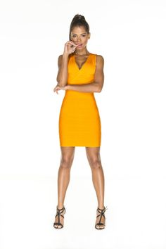 Deep v neck orange body con luxe bandage dress. Product number:B2954 This tropical colour is a must have statement dress. Excellent cleavage booster! Thalia wears a size S/ EU size 36/ US size 4 and her height is 5'8″ 60% Viscose, 30% polyester