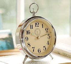 I have adored this Pottery Barn Vintage Clock for a long time! It is accent pieces like that create interest in a ho hum space like side table or bookshelf!