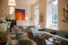 Rendered in a soft palette of greens and grays, Texture is one of London's premier destinations for Champagne