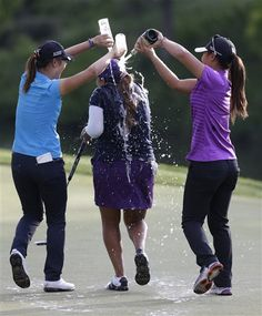 Lydia Ko, left, and Danielle Kang, right, douse Lizette Salas, with sparkling wine and water as she celebrates winning the Kingsmill Championship golf tournament at the Kingsmill resort in Williamsburg, Va., Sunday, May 18, 2014. (AP Photo/Steve Helber) ▼18May2014AP|Salas wins by 4 at Kingsmill; first LPGA victory http://bigstory.ap.org/article/salas-wins-4-kingsmill-first-lpga-victory #Lizette_Salas #Lydia_Ko #Danielle_Kang
