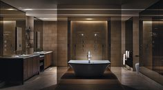 Sumptuous walls of smoky glass play a dramatic role in this technologically advanced master suite.