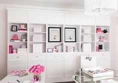 "Pretty Bookshelves and Storage using 3 Ikea Besta double bookcases with doors, 6 Besta Vassbo drawer inserts, 6 shelf unit/height extension nits with doors, Restoration Hardware round glass pulls, 1"" boxed frame built around it"