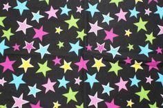 Neon Stars on Black Cotton Lycra Knit FAbric