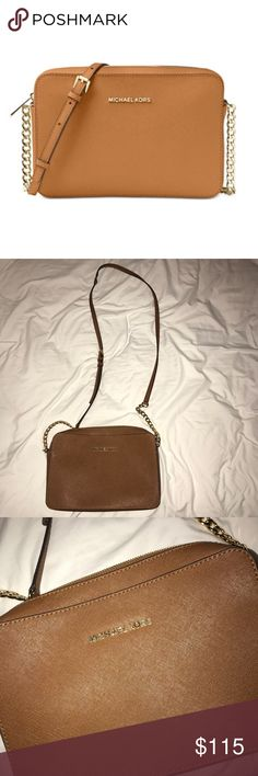 NEW Michael Kors Jet Set Crossbody Never used MK large Jet Set Saffiano Leather Crossbody. Never used and no signs of use. The color is called Acorn. Michael Kors Bags Crossbody Bags