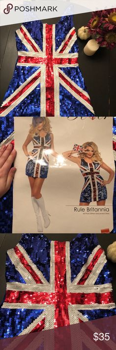Glittery Union Jack Dress Never Worn! Was going to wear with the white gogo boots for Halloween as an Austin Powers Chick, but ended up changing my mind! Really cute! Size runs a little big and no glitter on the back of dress just straight blue. 🇬🇧💙❤️✨ Dresses Mini