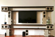 Industrial style wood plank and cinder block entertainment/media center. Design by Nisha Jacqueline Diy, industrial chic, wood plank, cinder blocks