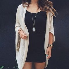 Black dress | oversized beige cardigan | necklace | watch | bracelet