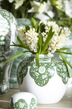 White lilac in a green and white ginger jar vase