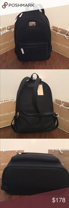 "MICHAEL KORS Jet Set Lg Back Pack Black Guaranteed Authentic! Michael Kors jet set large backpack in black and gold tone hardware. Water nylon fabric, and adjustable straps in saffiano leather. Approx. measurements: 16""H x 11""L x 5.5""W. Interior fabric lining with MK logo, one zipper pocket and 5 slid pockets. One exterior front zipper pocket. Item will be videotaped prior to shipping to ensure proof of condition. Michael Kors Bags Backpacks"