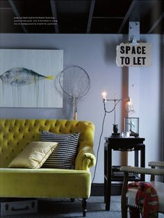 High back buttoned yellow sofa.
