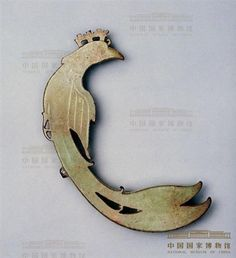 Jade Dragon, Phoenix, and Ornament in the Shape of Dragon and Phoenix Shang Dynasty (c. 16th–11th centuries BC), King Wu Ding's reign Unearthed from tomb of Fu Hao at Yinxu, Anyang, Henan Province, 1976 By National Museum of China