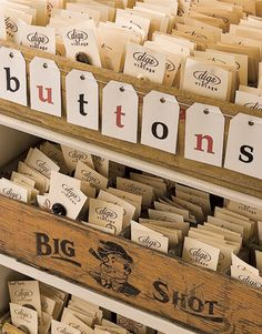 Vintage buttons are stored in old soda pop crates at Digs.. I would love some of these vintage crates as craft storage. I just love this look.