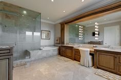 Traditional Master Bathroom with Crown molding, Limestone counters, Flush…Check in to countertops.  DMG
