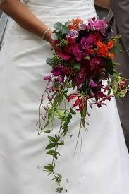Image result for cascading dark pink freesia bouquet
