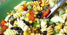 Black Bean & Corn Pasta Salad With Tri-color Pasta, Black Beans, Frozen Corn, Rotelle, Green Onions, Bell Pepper, White Onion, Fresh Cilantro, Zesty Italian Dressing