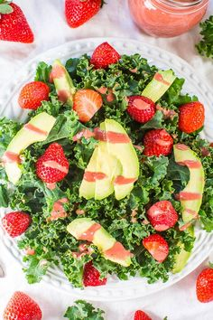 Strawberry, Avocado, and Kale Salad with Strawberry-Apple Cider Vinaigrette - Make a kale lover out of anyone in this healthy salad with creamy avocado and juicy berries!