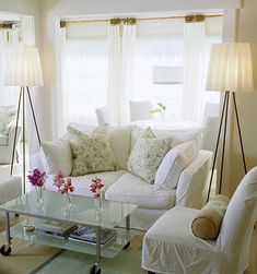 Modern Cottage Living Room - loving the white slipcovers and the lamps, but I'd do a white wood coffee table.