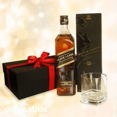 JOHNNY WALKER BLACK LABEL A bottle of Johnny Walker Black Label and a whiskey tumbler beautifully presented in a black box with red ribbons and bows. Bottle of Johnny Walker Black Label whiskey Whiskey tumbler South African Wine, Wine And Liquor, Gift Hampers, Black Box, Red Ribbon, Corporate Gifts, Ribbons, Special Gifts, Whiskey Bottle